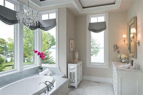 chandelier  tub transitional bathroom studio