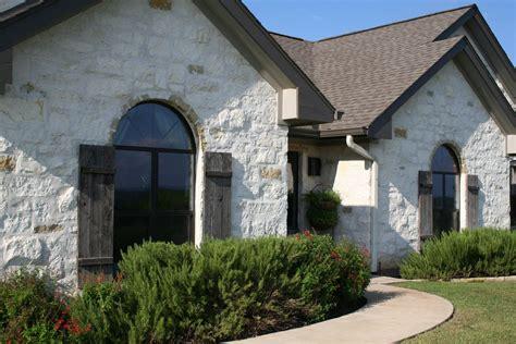 exterior home design jobs white stone exterior farmhouse with limestone cast tiered