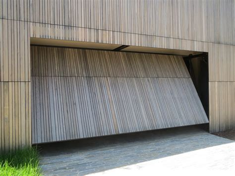 garage door system smartech s tilt garage door system opens as a single panel totalling within the boundary of the