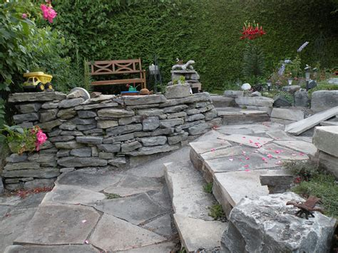 Raised Rock Garden Raised Bed Rock Borders My Wall Is Starting To Shape Up Nicely After A Few Years Of