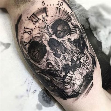 clock skull tattoo on inner bicep