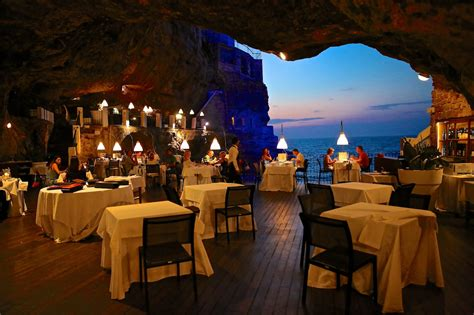 cave restaurant side of a cliff italy dining table settings pictures grotta palazzese polignano