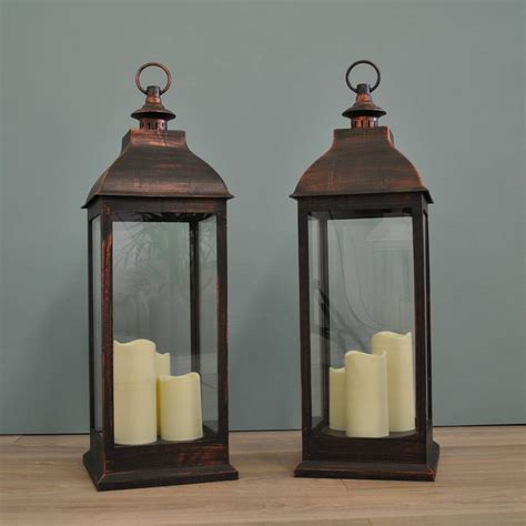 candle lanterns two firenze battery operated candle lanterns in copper by