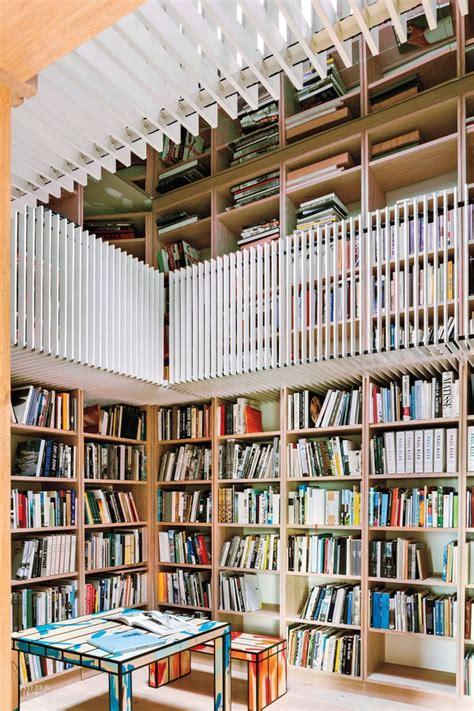 a2arhitektura library interior transformation transformation a centuries old barn into a vibrant art