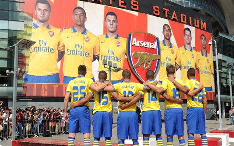 images arsenal officially launch   nike  kit  yellow blue shirt