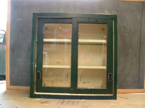 Metal Cabinet With Glass Doors Vintage Stackable Metal Cabinet With Sliding Glass Doors