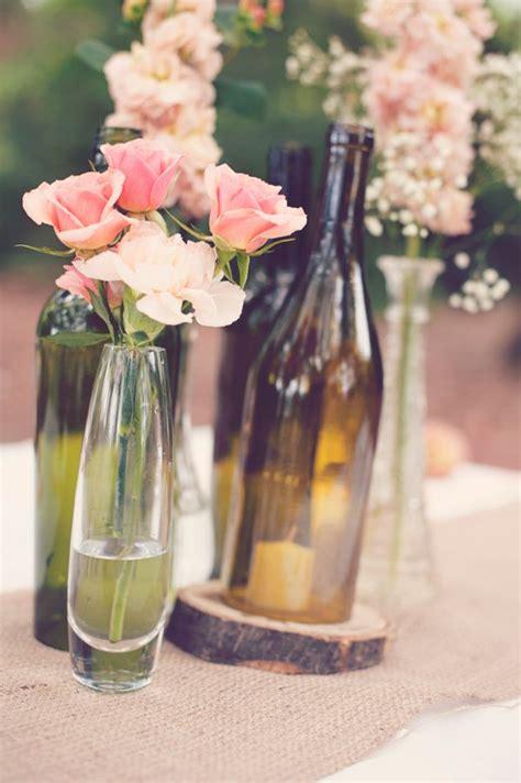 pink rose centerpieces wine bottles as flower vases