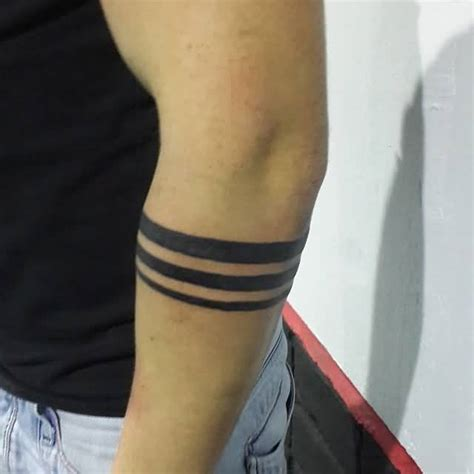 solid black armband tattoo designs lower armband tattoos and photo ideas page 8