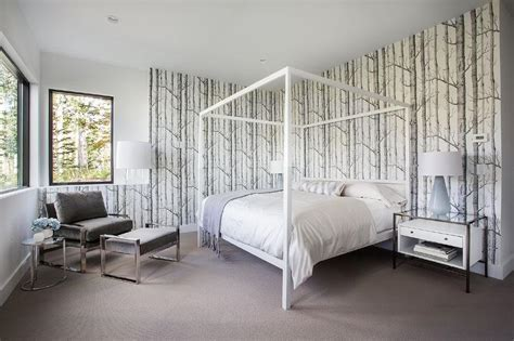 White and Gray Bedroom with White Canopy Bed and Glass