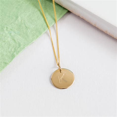 personalised solid 9ct gold initial disc pendant by auree