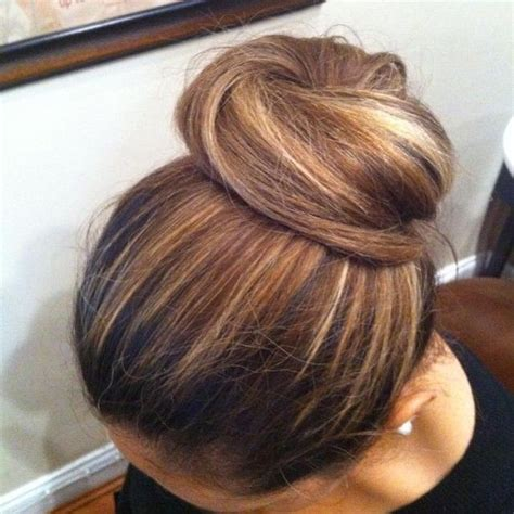 chigon blonde highlights chocolate caramel highlights high bun hair beauty