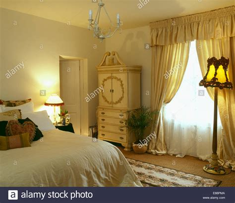 curtains for yellow bedroom white voile and yellow silk curtains on window in pale