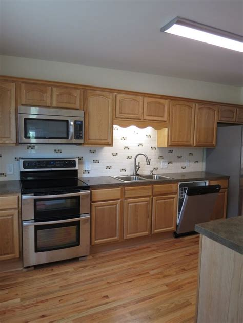 staining unfinished kitchen cabinets furniture modern chrome built in kitchen stove and oven