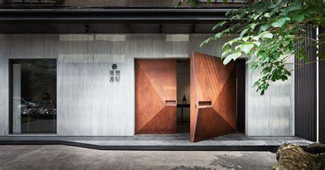 geometrically shaped weathered steel doors