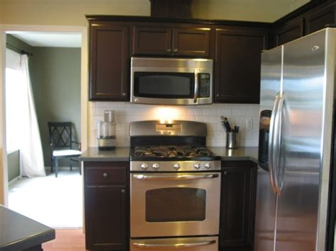 Diy Gel Stain Kitchen Cabinets After Diy Gel Stained Cabinets New Counters And Stainless Appliances Mahogany Gel Stain Is