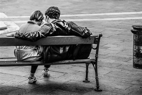 two people sitting on a bench grayscale photo of two person sitting on a bench 183 free