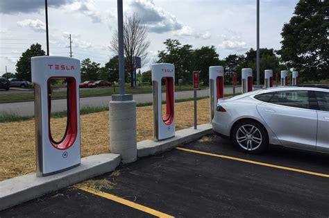 Supercharging Tesla Supercharging A Tesla Model S At A Grocery Store