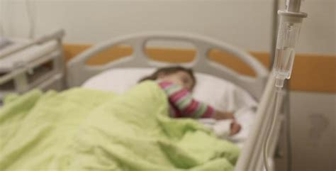 kid in hospital bed mother convinced doctors to perform surgery on her