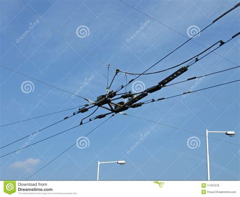 blue wires in electricity wires power isolator blue sky white clouds royalty free