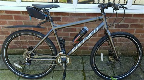 carrera subway subway 2 hybrid bike brand new one month with accessories and receipts for