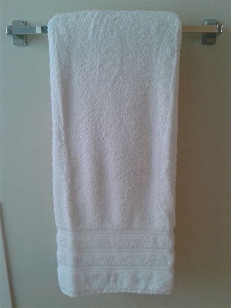 how to hang towels in bathroom homekeeping tip a better way to fold towels cclem