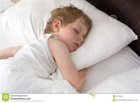 little sweet toddler boy sleeping in his bed royalty free