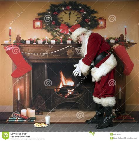 Santa Fireplace Picture by Santa Warming By The Fireplace Stock Photo Image 46002358
