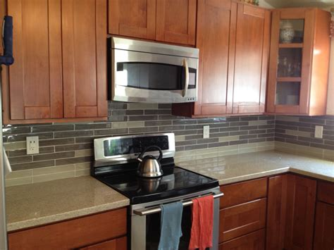 kitchen backsplash cherry cabinets mission style cherry cabinets with ground quarts counter