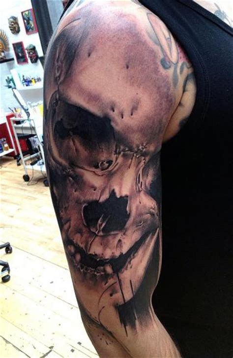 shoulder skull tattoo by vicious circle tattoo