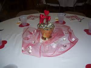Christmas Dinner Table Centerpieces - small brown glass with red ribbon also tile fabric combined with glasses on the round table of