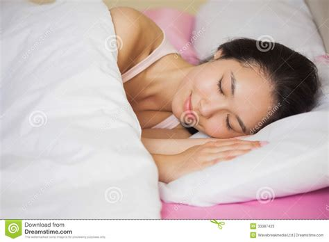 sleeping in asia peaceful young asian woman sleeping in her bed stock image