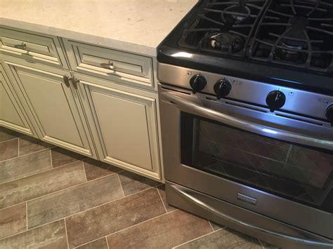 antique white kitchen cabinets with quartz countertops kitchen antique white cabinets quartz countertops john