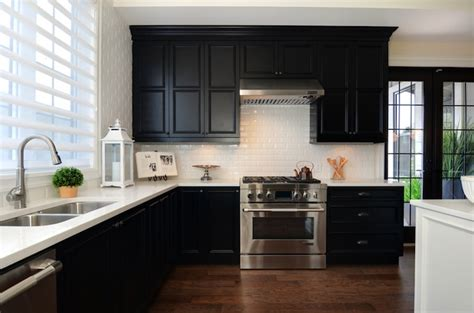 black and white cabinets black countertops and white cabinets transitional