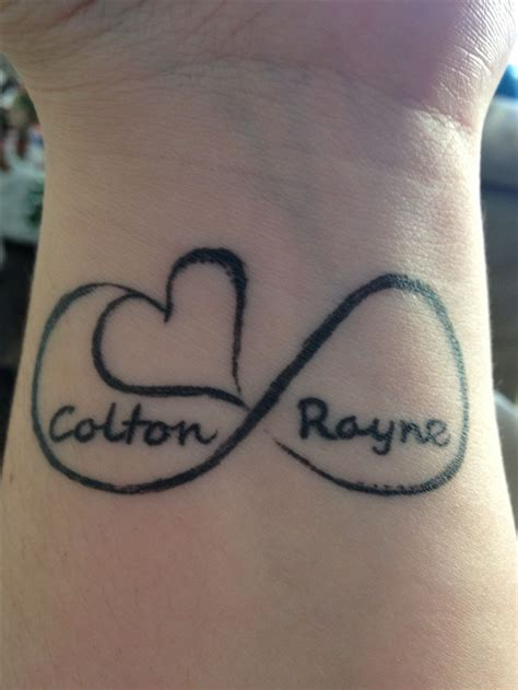 i want a tattoo wrist i so want this with and s name