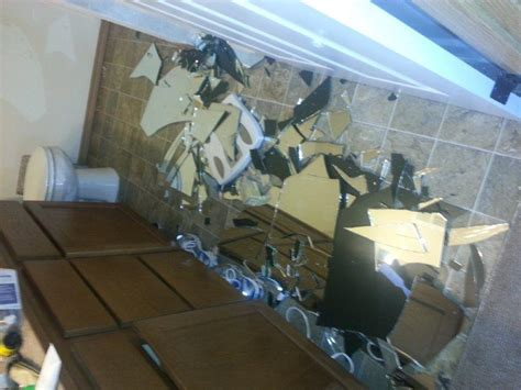 broken bathroom mirror shattered mirror floor gurus floor