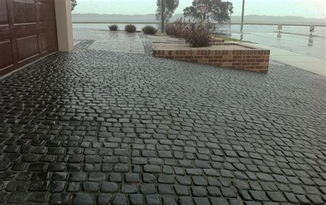 Natural Stone Driveway cobblestone pavers both loose and on mesh sheets