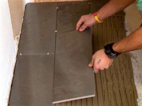 how to install a plank tile floor how tos diy - Laying Tiles In Bathroom