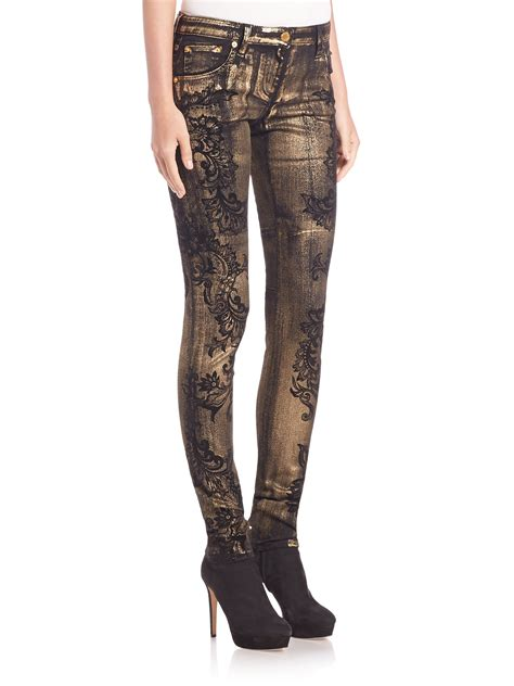 black patterned jeans roberto cavalli printed metallic skinny jeans in black lyst