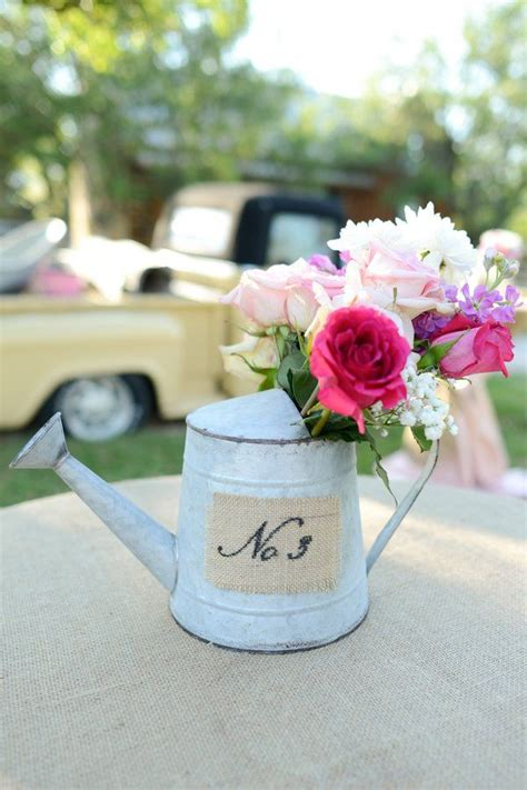 water can centerpieces 1000 ideas about watering can centerpieces on