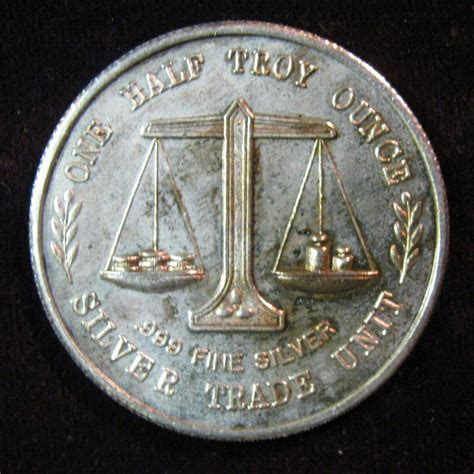 1 Troy Ounce Silver - 40 one half troy ounce 999 silver trade