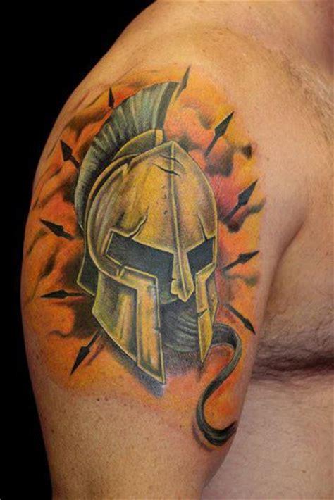 spartan armor helmet tattoo by paris pierides tattoos