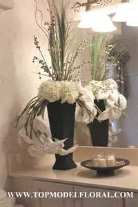 black and white flower centerpieces black and white floral arrangements in wicker vase