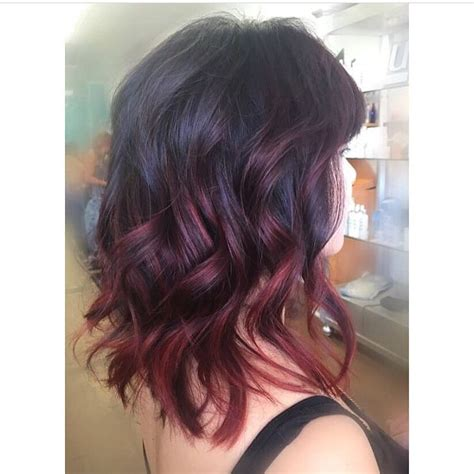 bayalage on medium layered hair wavy shoulder length hair with chunky layers and red