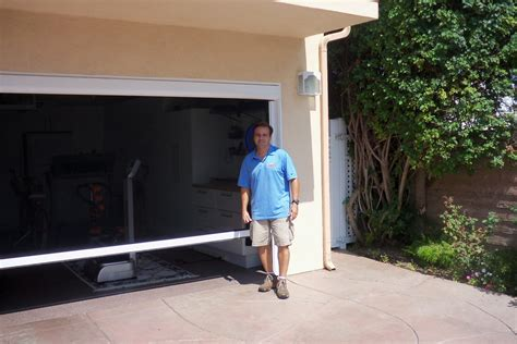 Screen For Garage Door Opening by Motorized Power Screen For Garage Door Window Screens