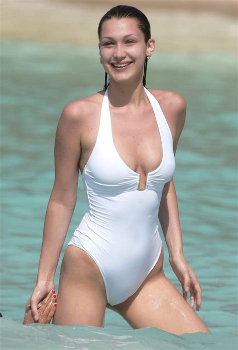 yolanda hadid shares a sexy bathing suit photo on vacation bella hadid rocks a white one piece swimsuit instyle com