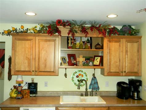 decorating above cabinets in kitchen pictures decorating above kitchen cabinets before and after