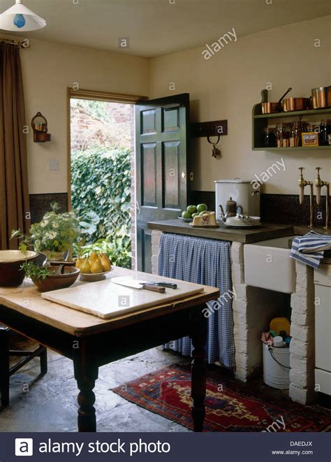 wooden table  center rustic country cottage kitchen