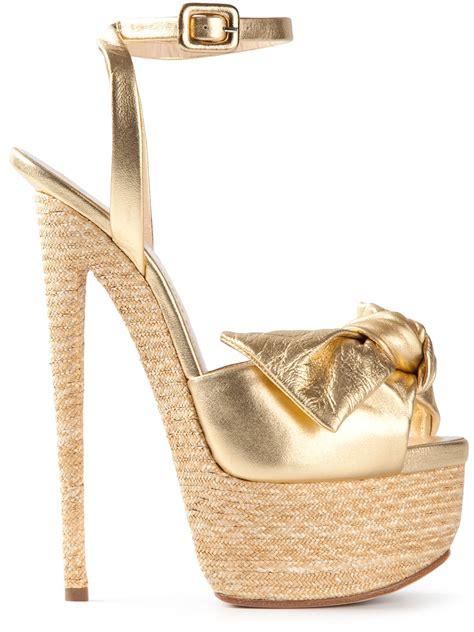 giuseppe zanotti gold sandals giuseppe zanotti bow platform sandals in gold metallic