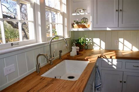 white cabinets  butcher block countertops  shaped