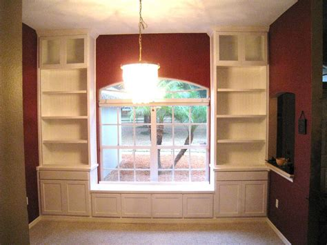 perfect window seat with bookshelves on furniture living